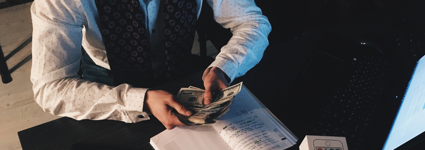 A man counting out money